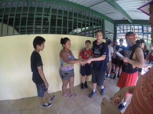 Handing each child school supplies