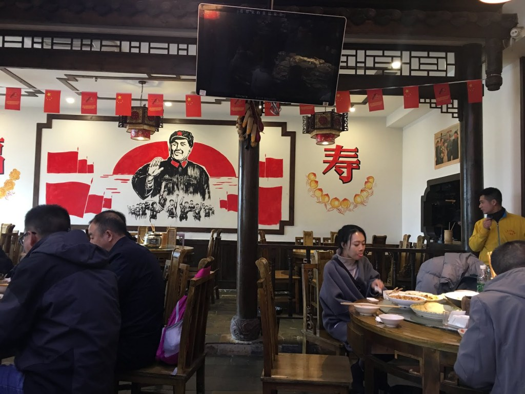 Photo inside a Chinese restaurant with people eating.